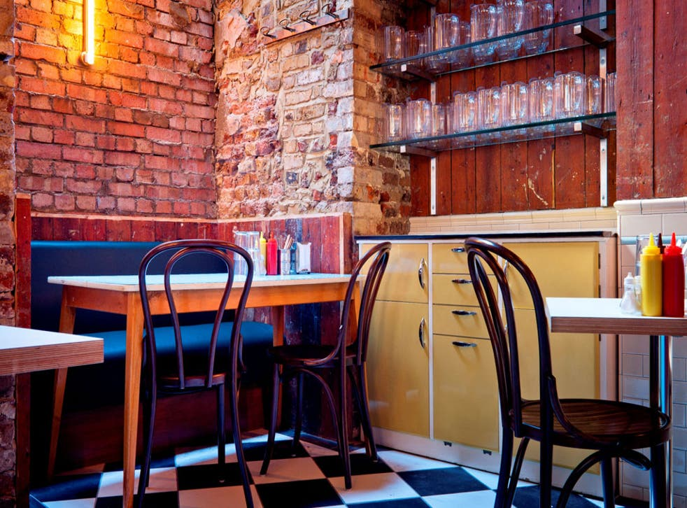 <p>Mishkin's is a cool, shabby-chic mix of reclaimed wood and scrubbed brick</p>
