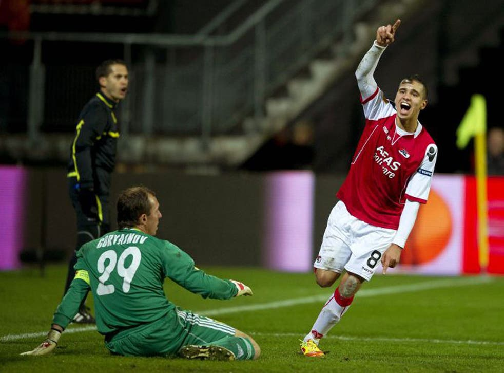 <p>Adam Maher celebrates after scoring against Metalist Charkiv for AZ</p>