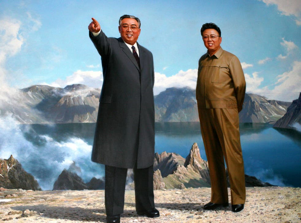 Kim Jong-il, right, and his father, Kim Il-sung, depicted at Mount Paektu, where the pair were both born, according to official records
