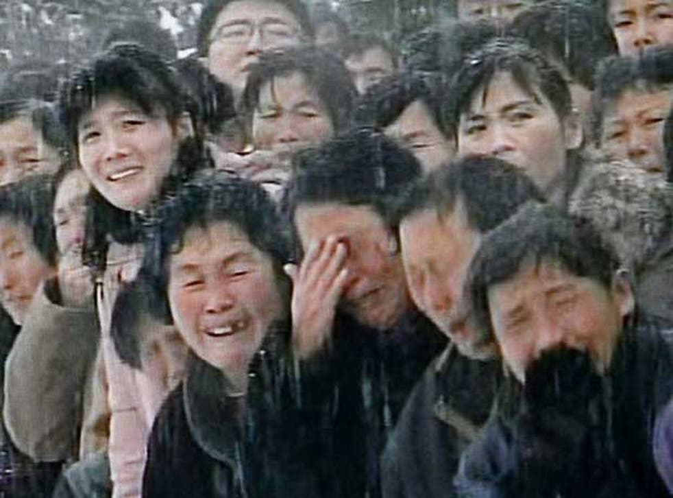 Mourners weep during the funeral procession for North Korean leader Kim Jong-il in snowy Pyongyang