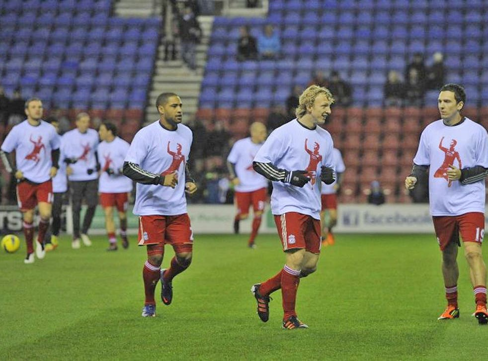 21 December: Liverpool players wear T-shirts in support of Suarez at Wigan