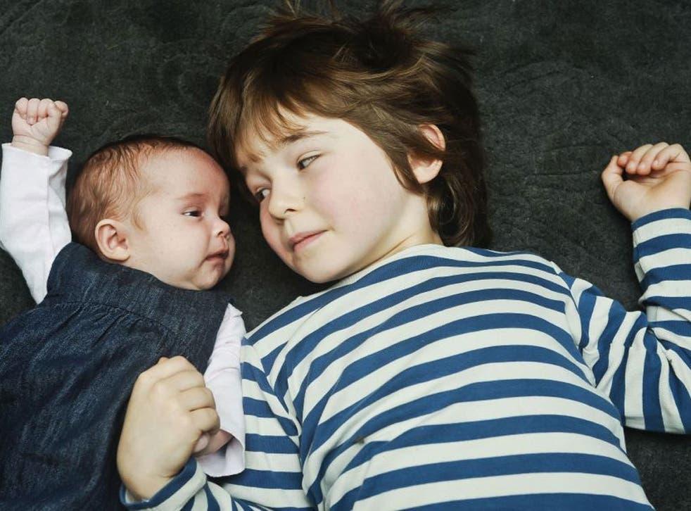 Reuben, five, with his seven-week-old sister Floren
