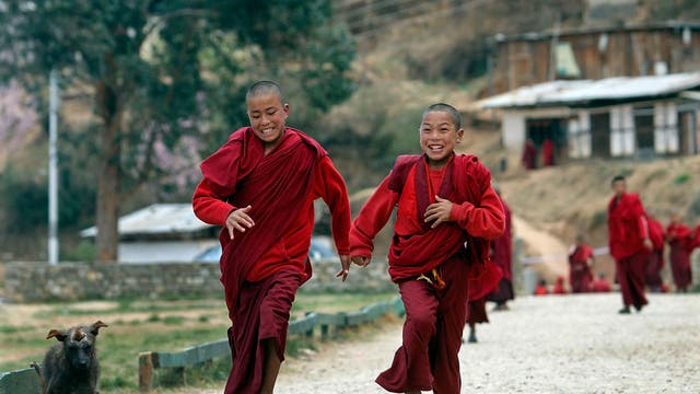 Young monks run back to class at the Dechen Phodrang monastery in Thimpu