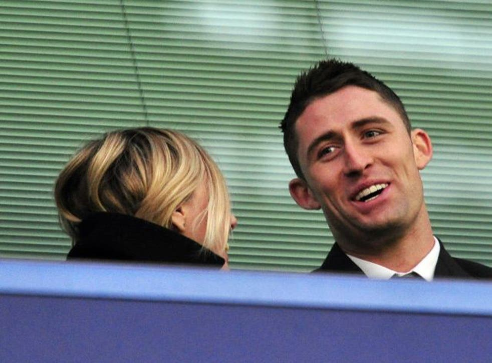 Gary Cahill watches his new Chelsea team-mates in action from the stands on Saturday