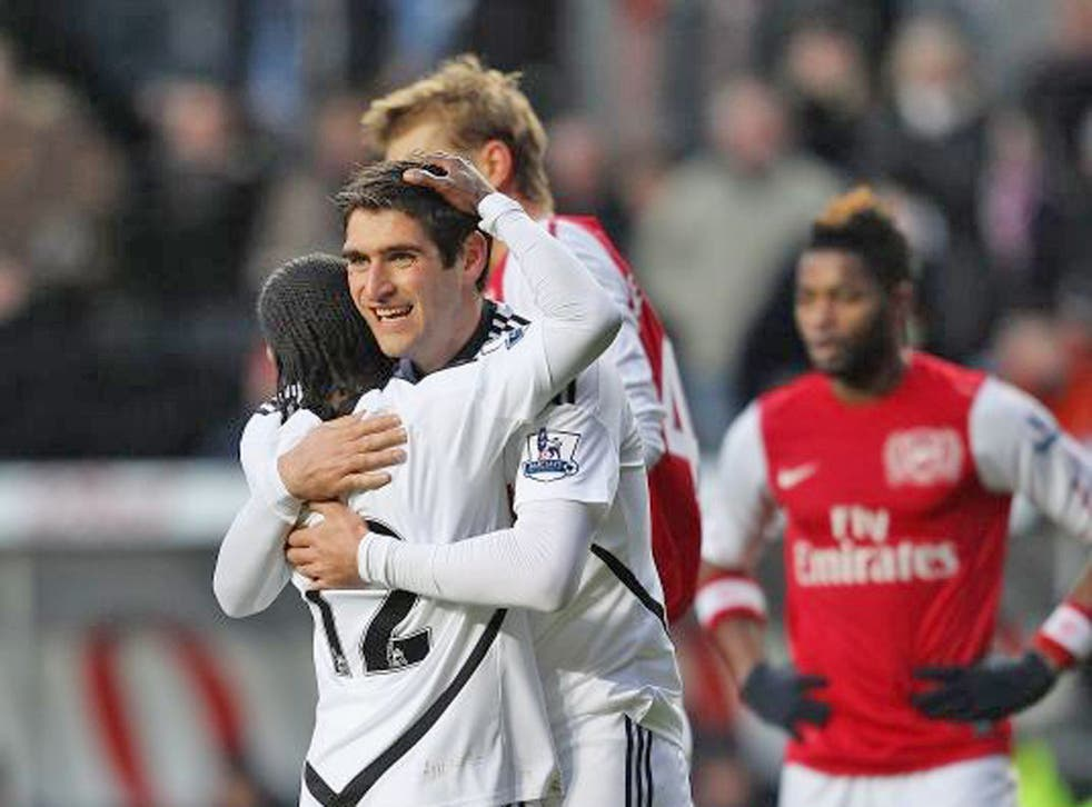 Match-winner Danny Graham hugs Nathan Dyer after Swansea were awarded a penalty