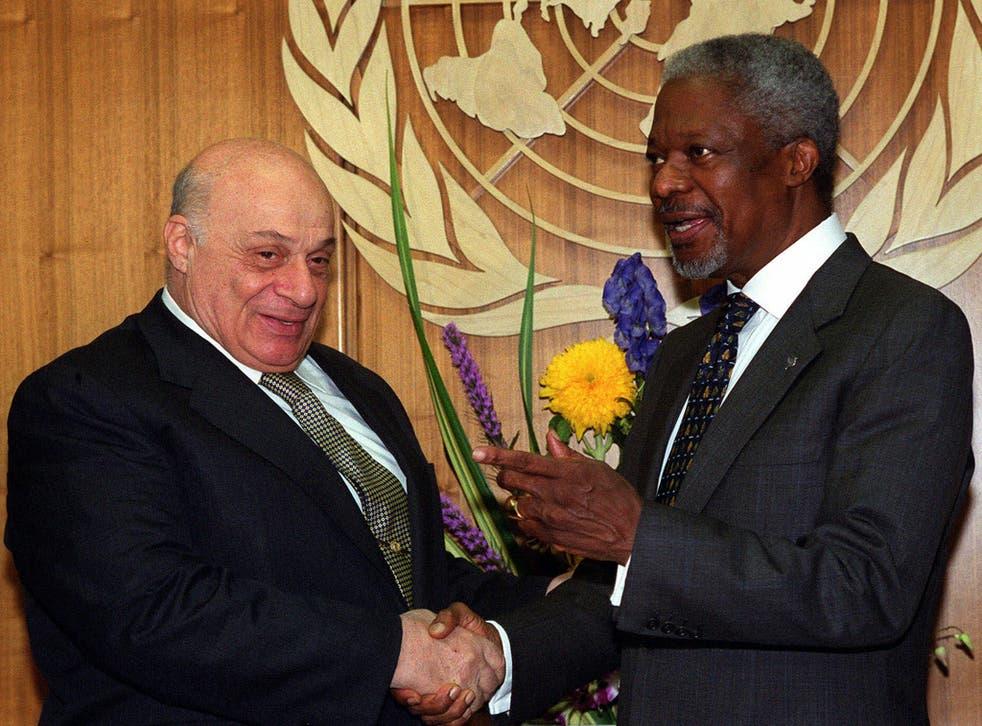 Denktash, left, meets the then UN Secretary-General Kofi Annan at the United Nations in 2000