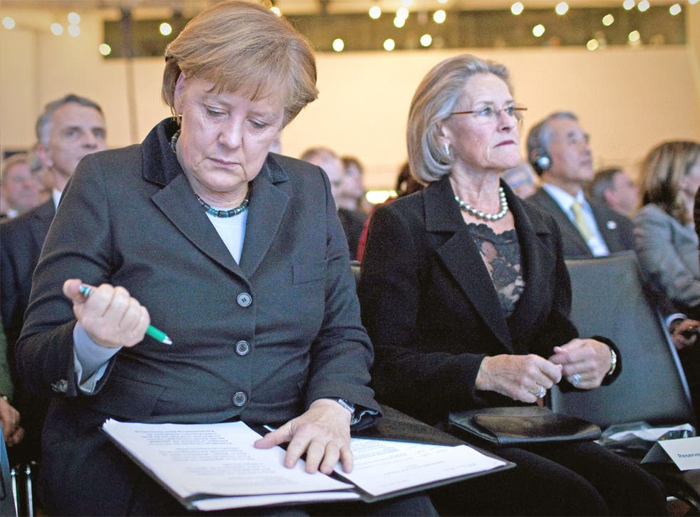 Angela Merkel works on her speech at Davos yesterday