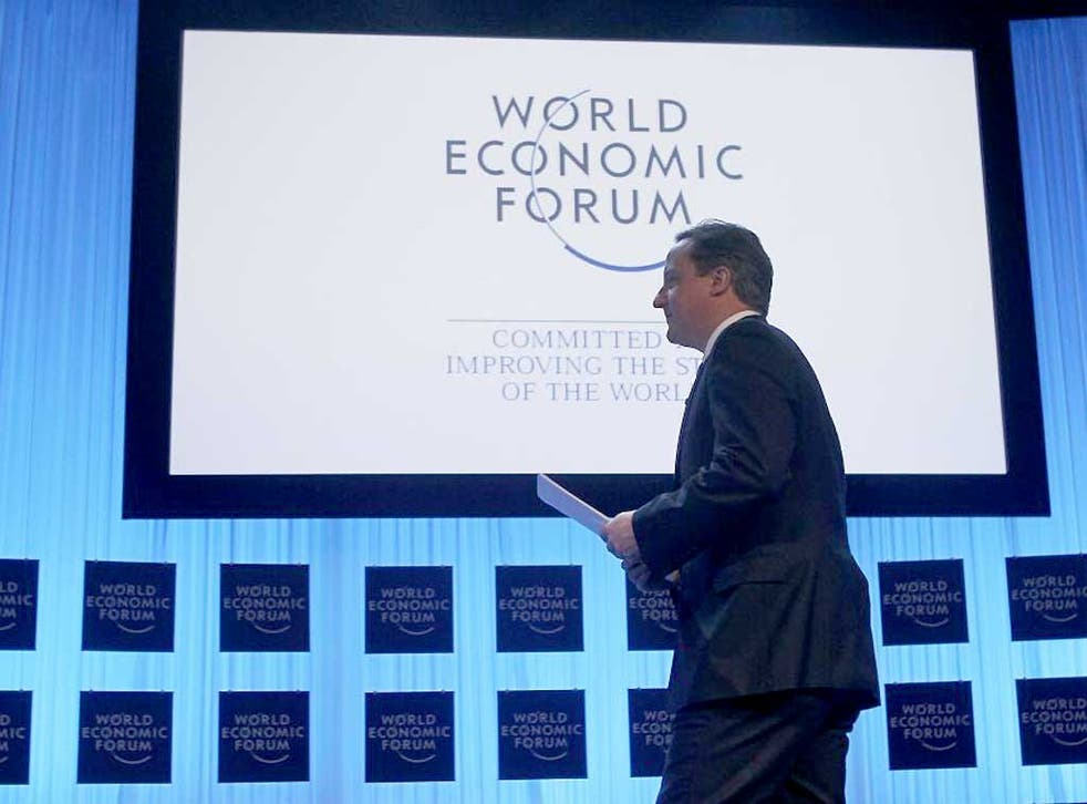 David Cameron arrives on stage at the World Economic Forum in Davos