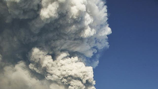 Big smoke: Mount Etna rumbles in the distance