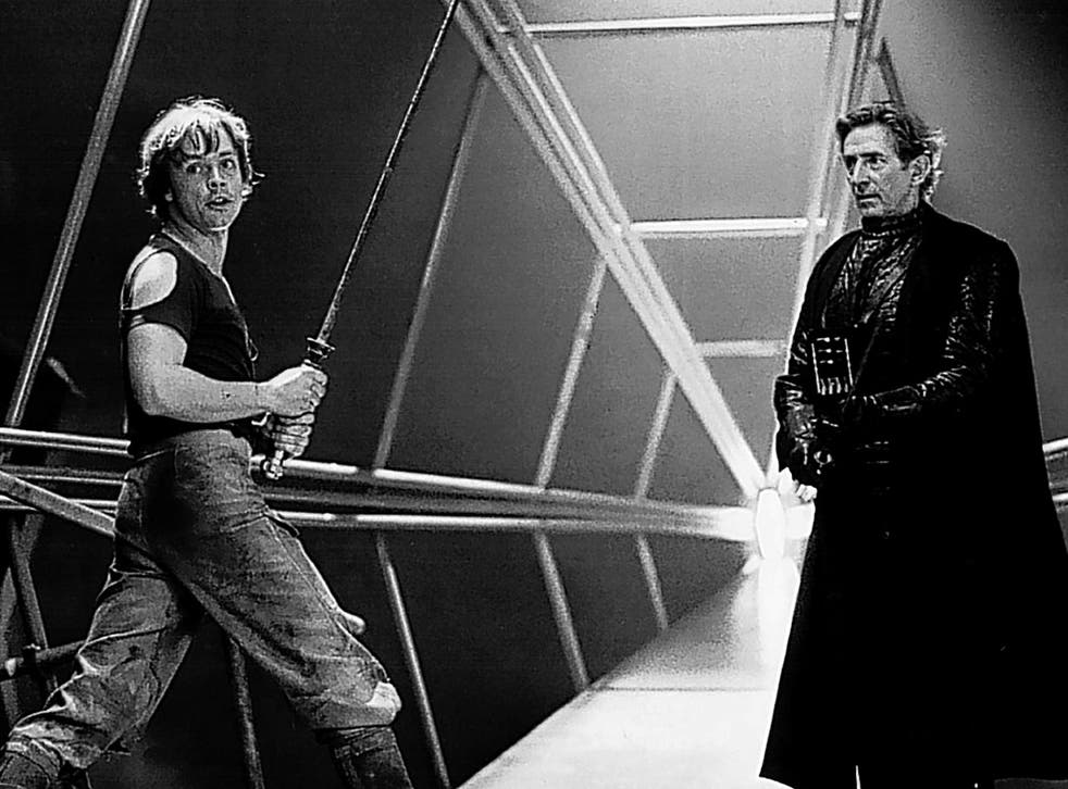 Anderson, right, rehearses a fight scene with Mark Hamill as Luke Skywalker on the set of 'Star Wars'