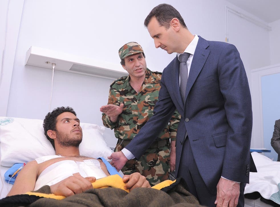 President Bashar al-Assad visiting wounded soldiers in hospital