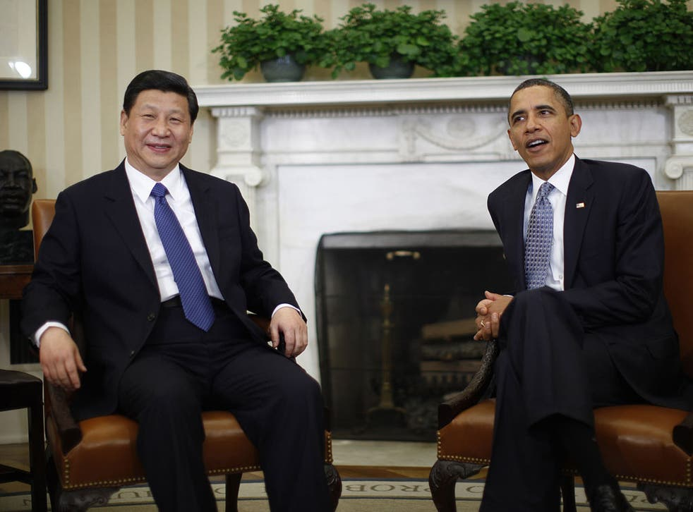 Barack Obama meets with China's Vice President Xi Jinping in the Oval Office