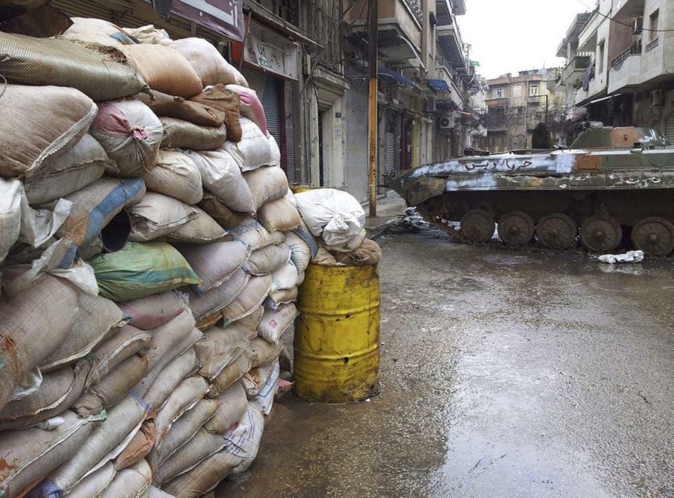 A damaged tank in the Bab Sabaa neighbourhood of Homs