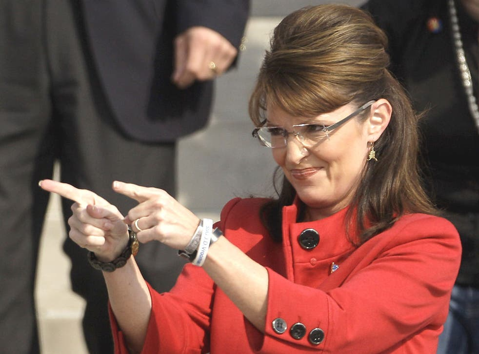 The real Sarah Palin greets the crowd during a 2008 election rally