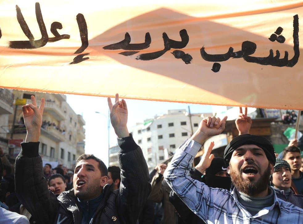 Demonstrators protest in Idlib