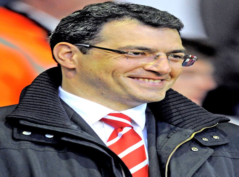 Comolli says Kenny Dalglish has 'done a tremendous job to put the team back on track'