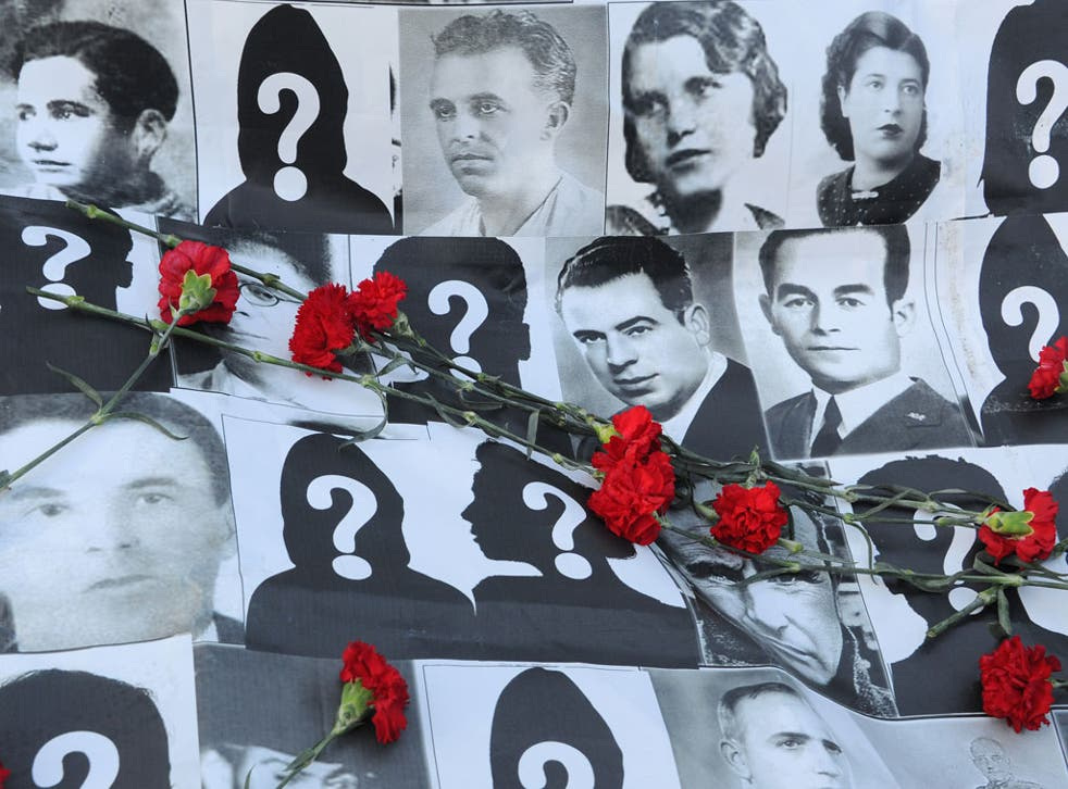 The past that has not passed away: A banner displays pictures of people who went missing during Spain's civil war, at a demonstration in Madrid, February 2012
