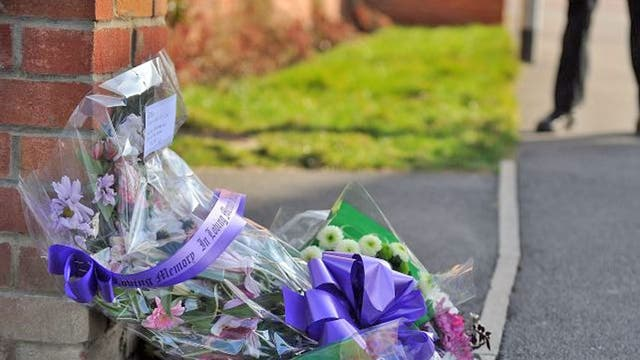 Floral tributes left outside the home of PC David Rathband yesterday