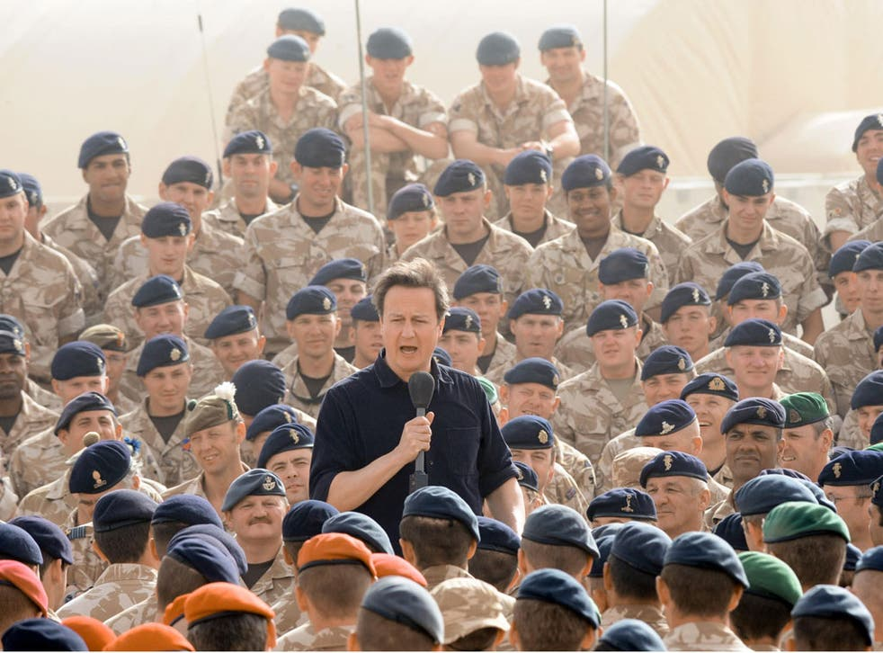 David Cameron at Camp Bastion last year. But there is work to do now