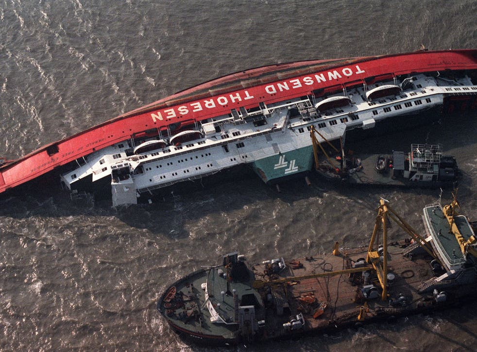 The capsized 'Herald of Free Enterprise' surrounded by rescue boats off Zeebrugge in March 1987