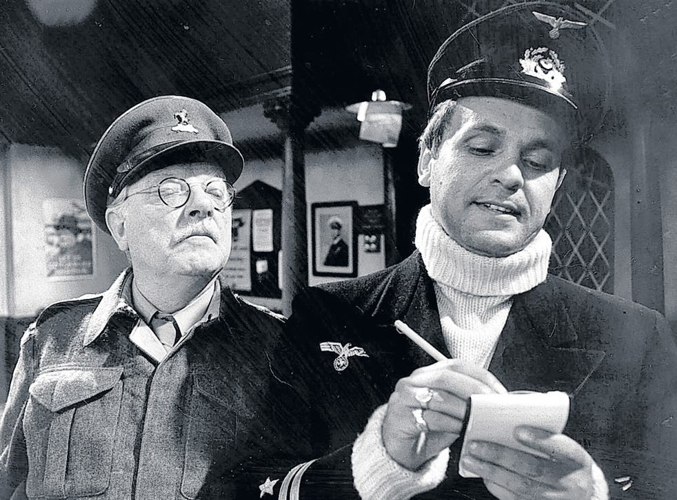 Arthur Lowe as Captain Mainwaring looks on as Madoc's U-boat captain takes down Pike's name in 'Dad's Army'