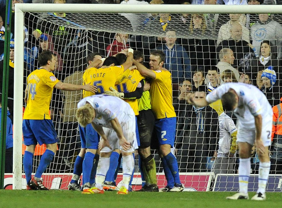 Southampton keeper Kelvin Davis is mobbed at the final whistle after almost single-handedly keeping Leeds at bay