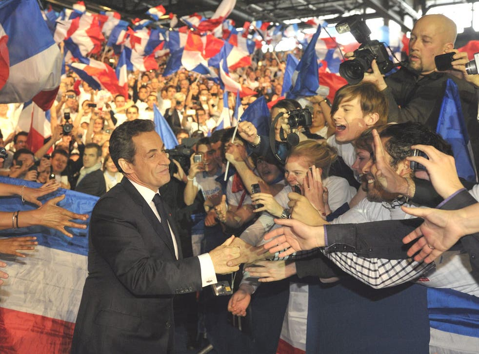 Nicolas Sarkozy is cheered by 40,000 supporters in Villepinte yesterday as he steps up his election campaign