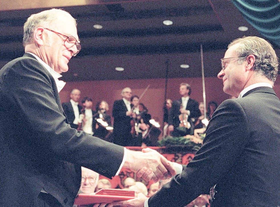 Sherwood, left, receives his Nobel Prize from King Carl XVI Gustaf of Sweden in Stockholm in 1995