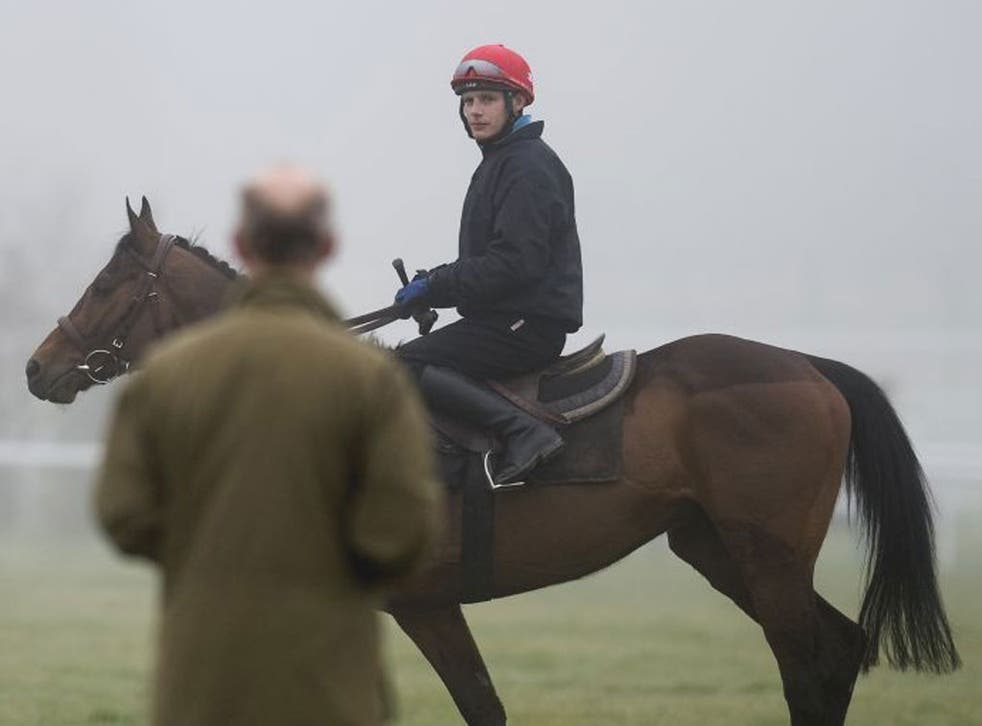 Trainer Willie Mullins and rider Paul Townend put the finishing touches to Hurricane Fly's preparations at Cheltenham yesterday