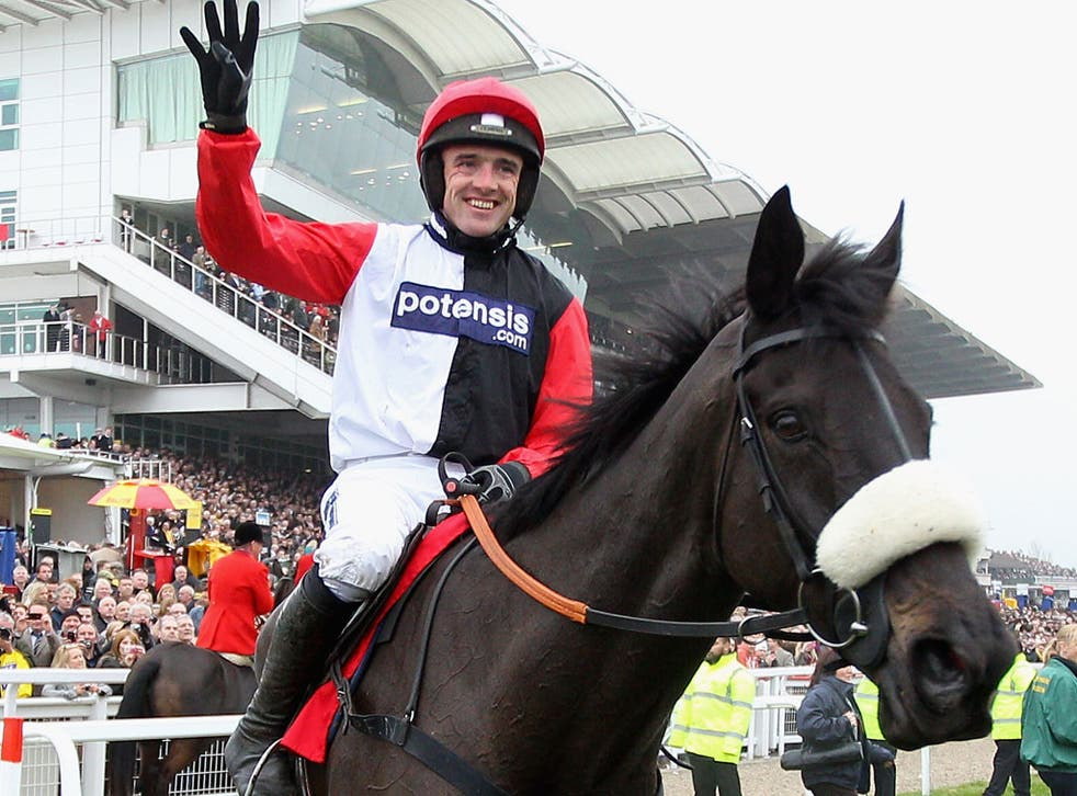 Ruby Walsh celebrates Big Buck's fourth victory in the World Hurdle at Cheltenham