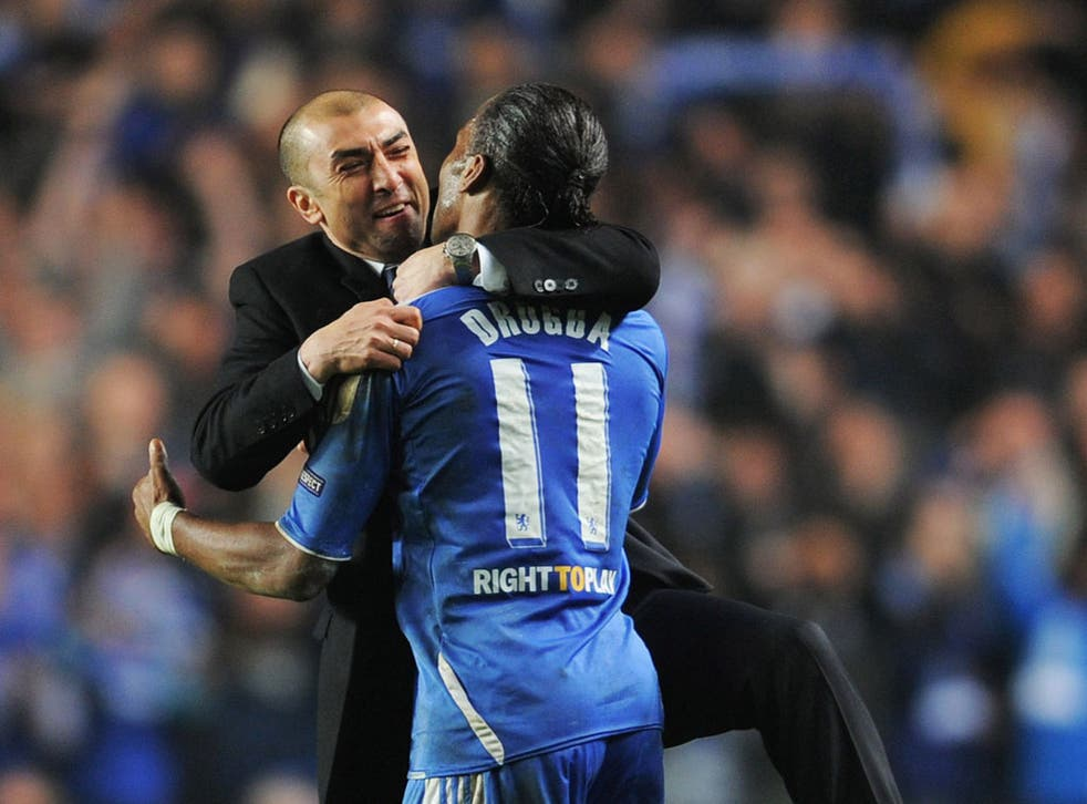 Chelsea manager Roberto Di Matteo enjoys the defeat of Napoli with Didier Drogba