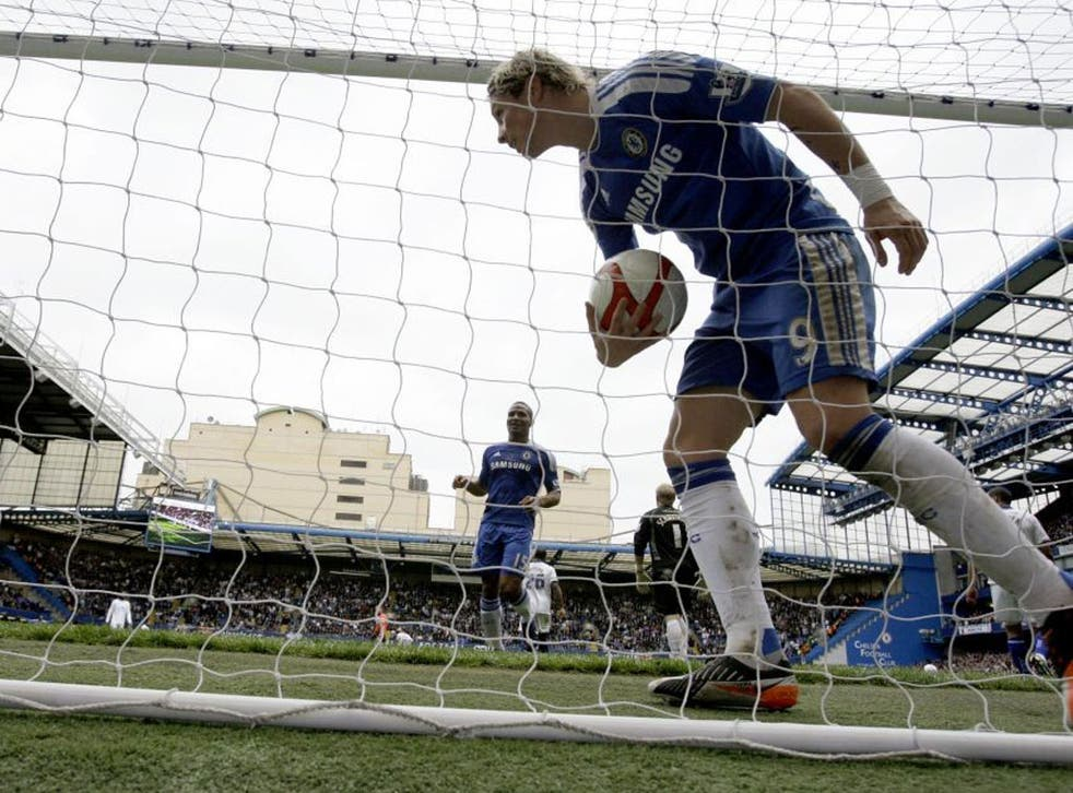 Fernando Torres retrieves the ball after scoring his first goal against Leicester