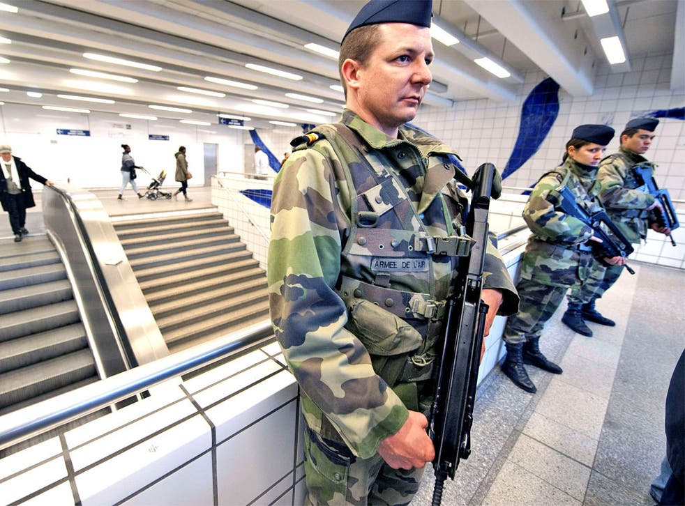 Soldiers stand guard in the subway in Toulouse after the third gun attack in a week