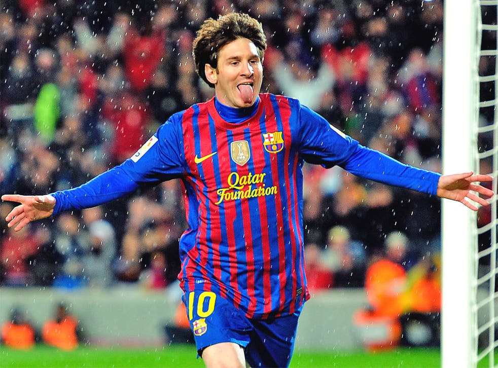 Hungry for a hat-trick: Lionel Messi celebrates one of his record-breaking Barça goals on Tuesday