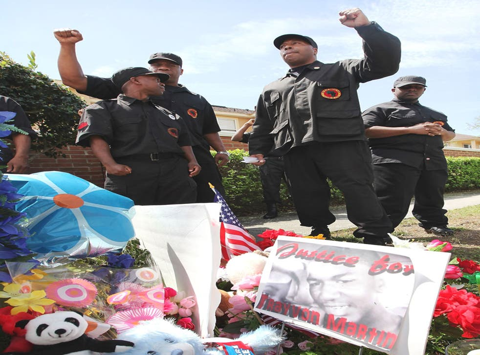 Members of the New Black Panthers cheered as their leader urged 'an eye for an eye' for the shooting