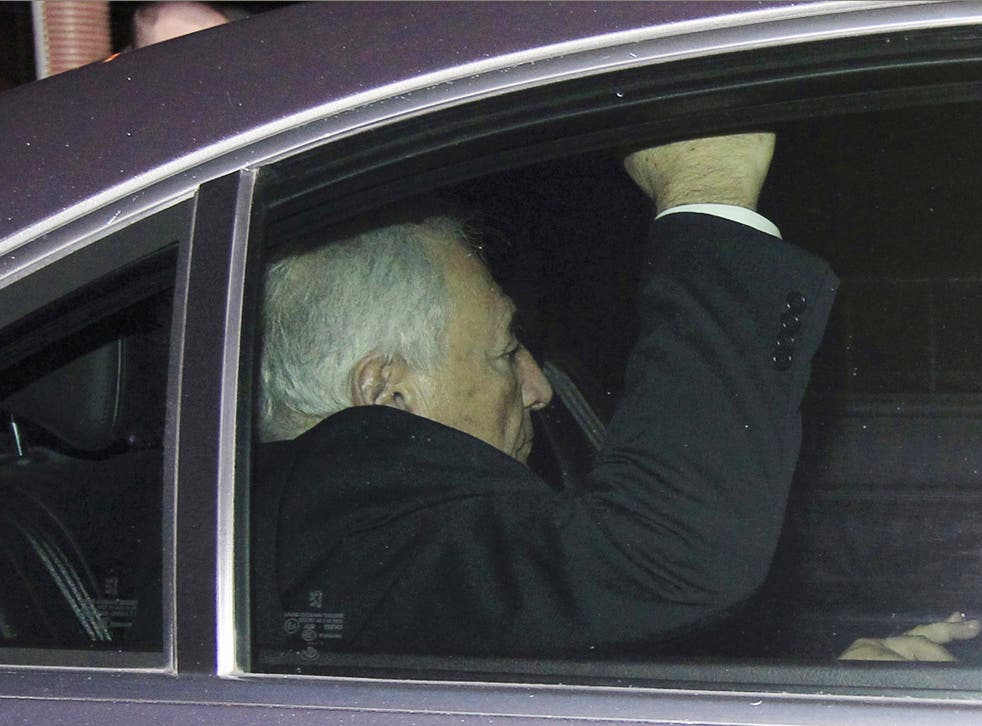 Dominique Strauss-Kahn leaves court in Lille after questioning by judges yesterday