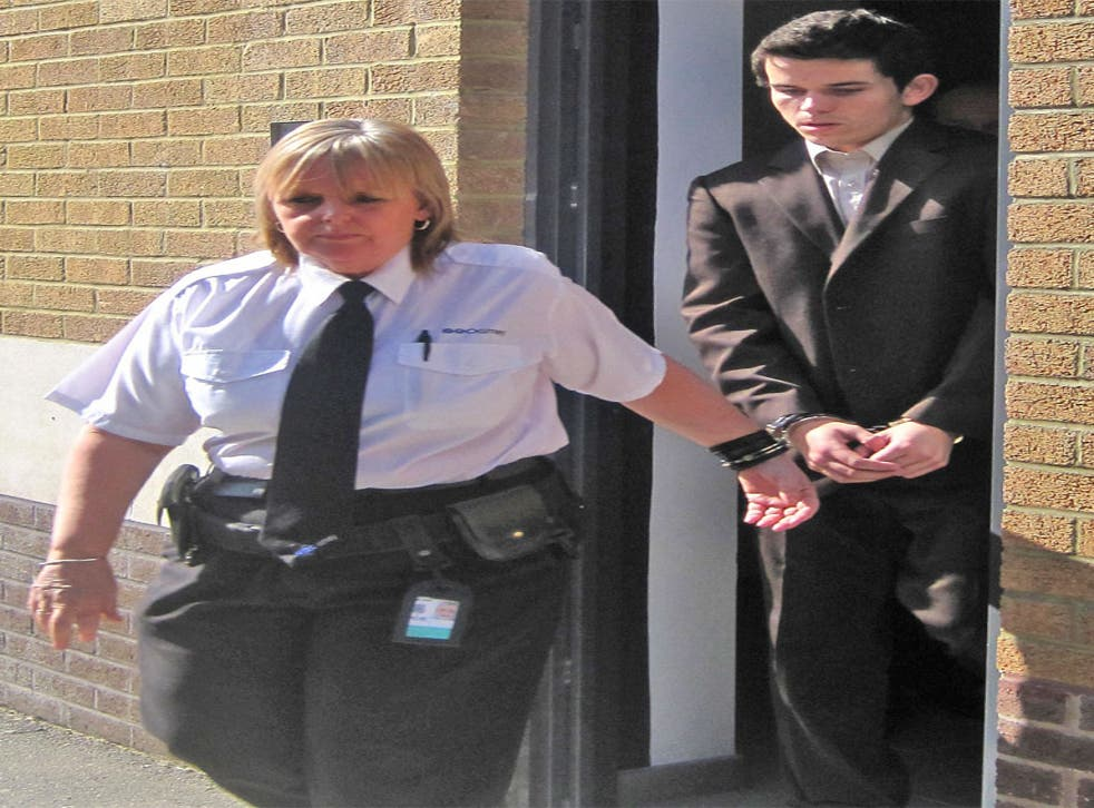 Sent down: Liam Stacey is led away outside Swansea magistrates' court