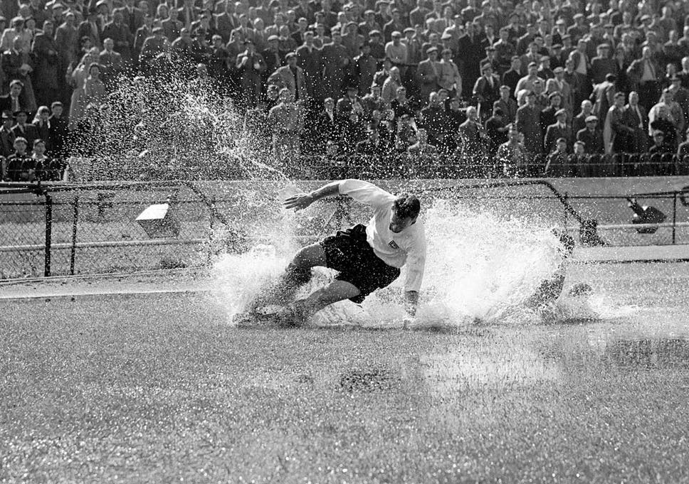 57506939d The iconic image of Tom Finney aqua-planing at Stamford Bridge in 1956  hangs in
