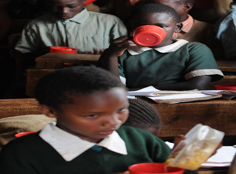 Ration Books: Pupils at a school in a Nairobi slum eat a meal provided by the World Food Programme