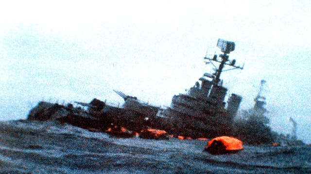 The Belgrano sinks amid orange life rafts holding survivors in the South Atlantic in May 1982
