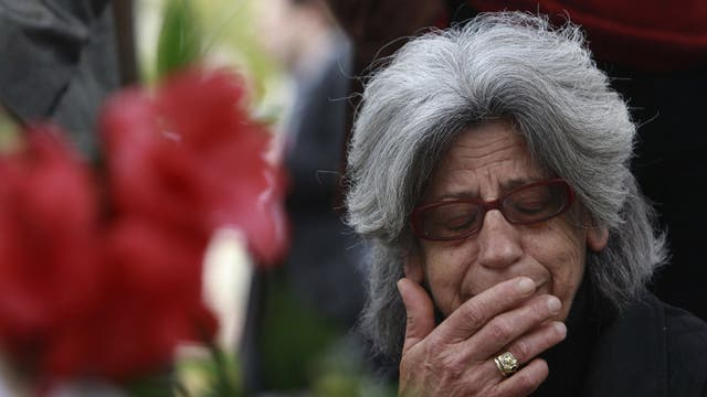 A woman cries at the spot where Dimitris Christoulas killed himself