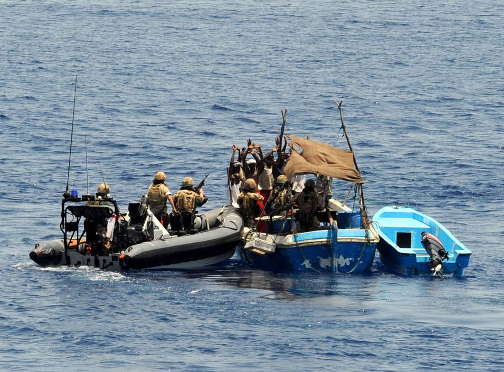 Marines from the Navy frigate HMS Portland intercepting and disarming pirates in the Gulf of Aden in 2009