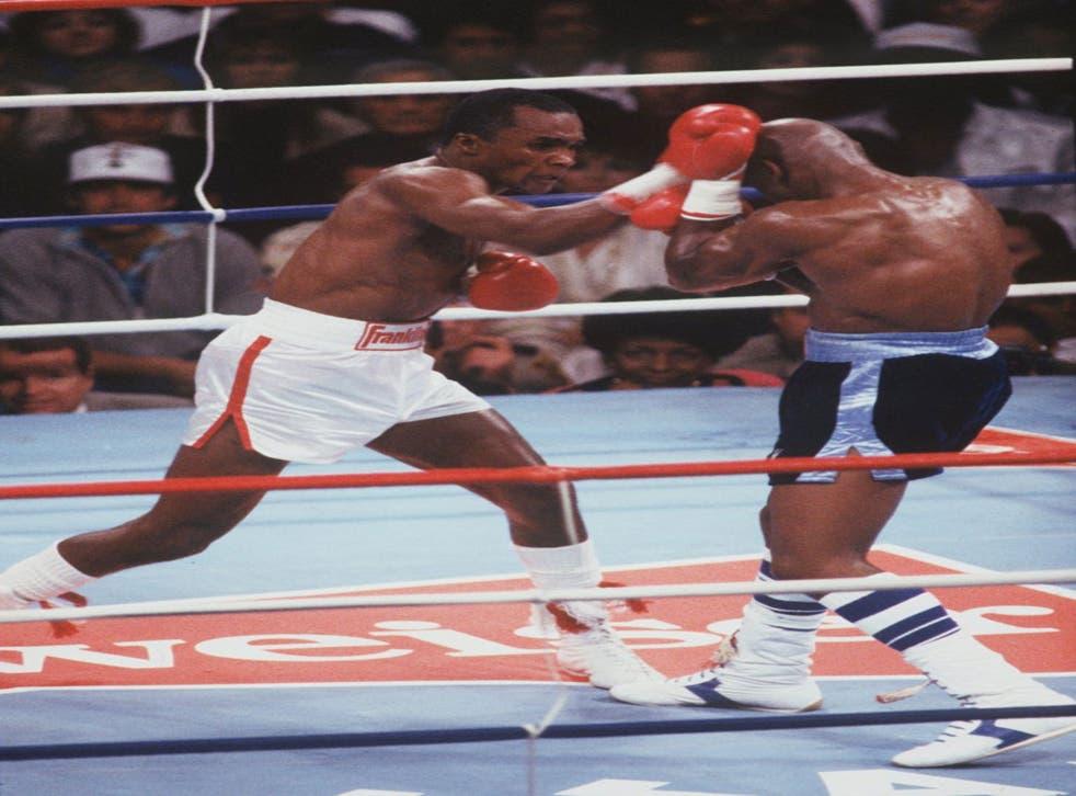 Sugar Ray Leonard throws a punch at Marvin Haglerin their 1987 bout