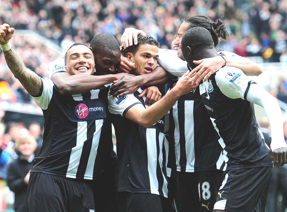 Hatem Ben Arfa (centre) is mobbed by his teammates after scoring the opener for Newcastle