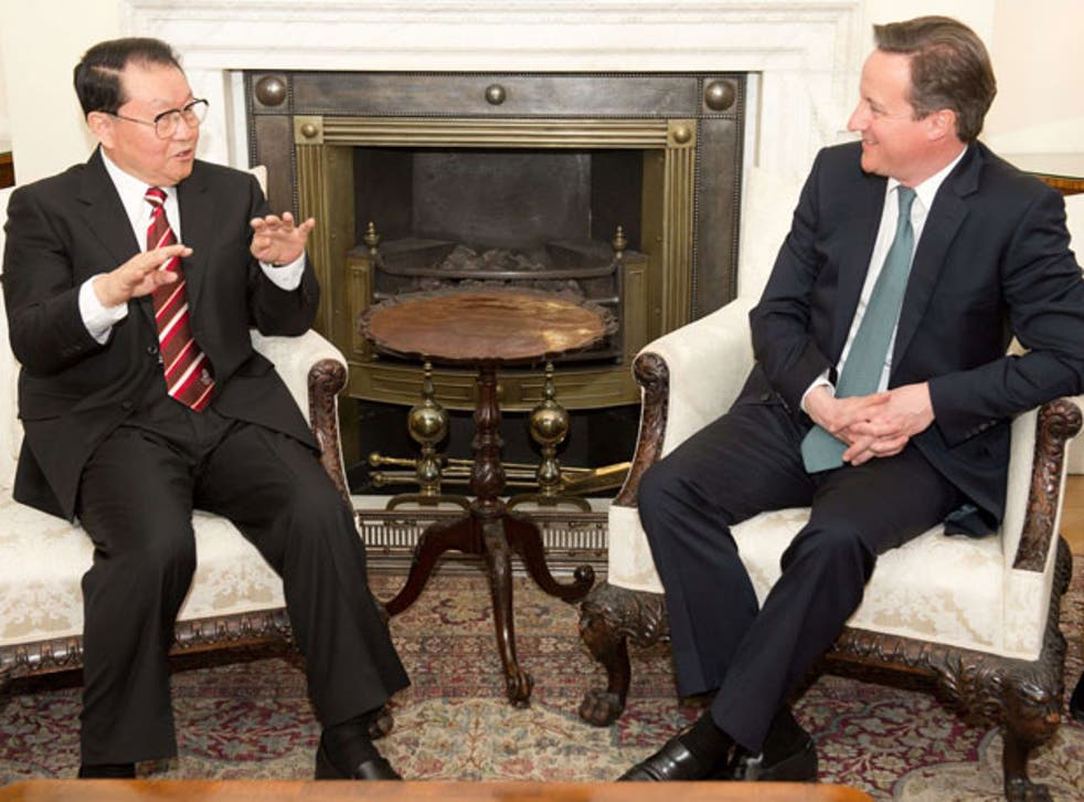 David Cameron (right) meets Chinese Communist Party official Li Changchun today