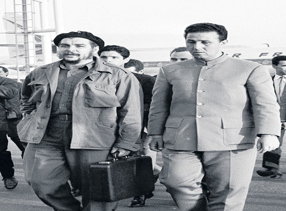 Comrades: Ben Bella, right, with Che Guevara at Algiers airport in 1964