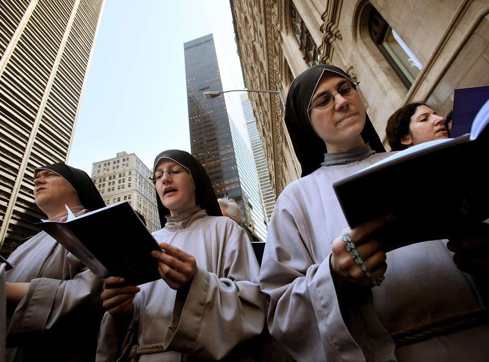 American nuns say prayers next to the World Trade Center site in New York
