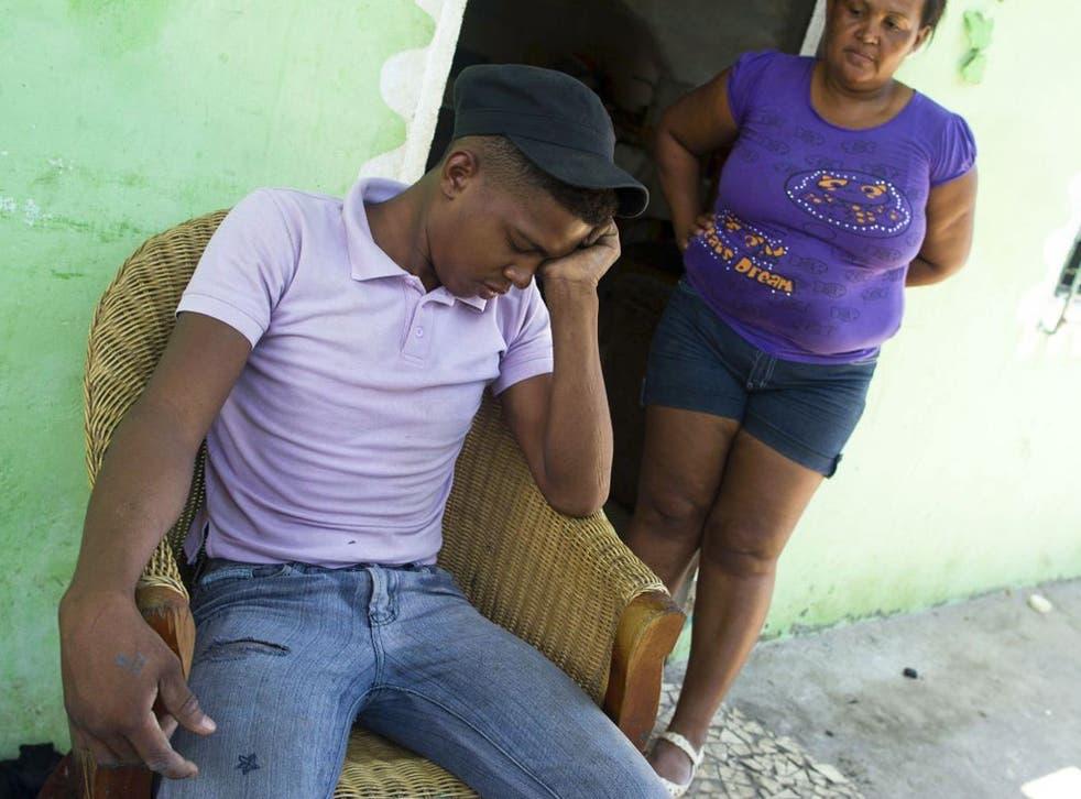 Adrian Vasquez, left, sits next to his mother, Nilsa De La Cruz, 42, right, outside his home in the town of Rio Hato, Panama