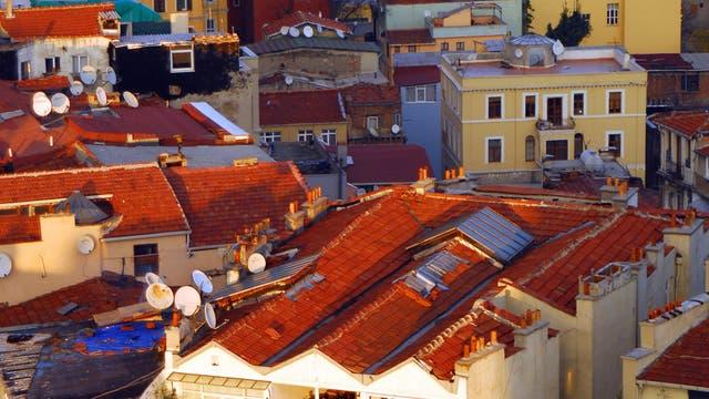 Winter evening sun on Pera - Beyoglu rooftops as seen from the Galata Tower