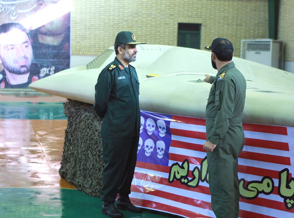 General Amir Ali Hajizadeh, left, with the US RQ-170 Sentinel drone